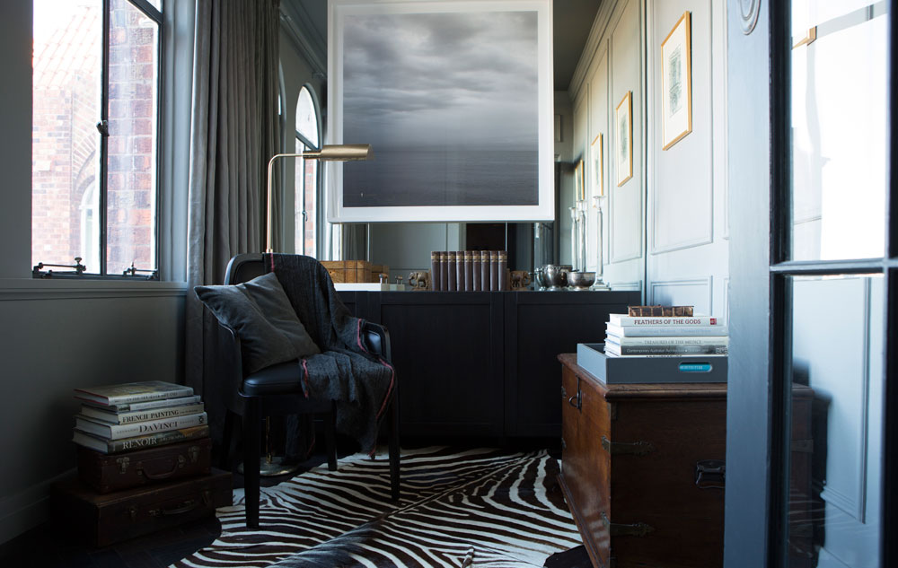 study small space brass lamp sandra kontos ode photography french door art deco georgian contemporary zebra rug vintage chest mcm house chair grey panelled wall elizabeth bay sydney australia xavier hinde interiors interior design brass lamp mirrored wall
